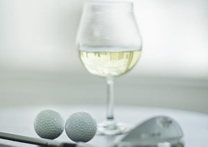 wine glass and two golf balls