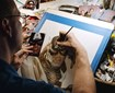 Photo of Alex Ross Drawing a Comic Book Cover